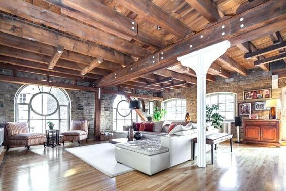 warehouse conversion in London ( living room).   Love the windows, exposed beams , and iron column.
