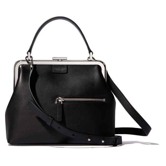 This little satchel has the super classic look of a vintage evening bag with a polished metal hinge closure, but the offset front pocket—perfectly sized for eas
