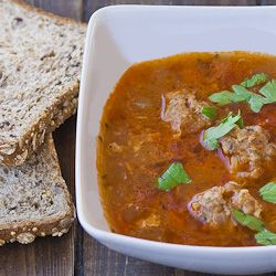 Romanian Meatball Soup- Good and satisfying with a few modifications. Only use half an onion for the meatballs, otherwise, you will have onionballs. Use 8 cups of liquid max. Also, sub bread crumbs for the rice in the meatballs because the rice doesn't cook all the way through.