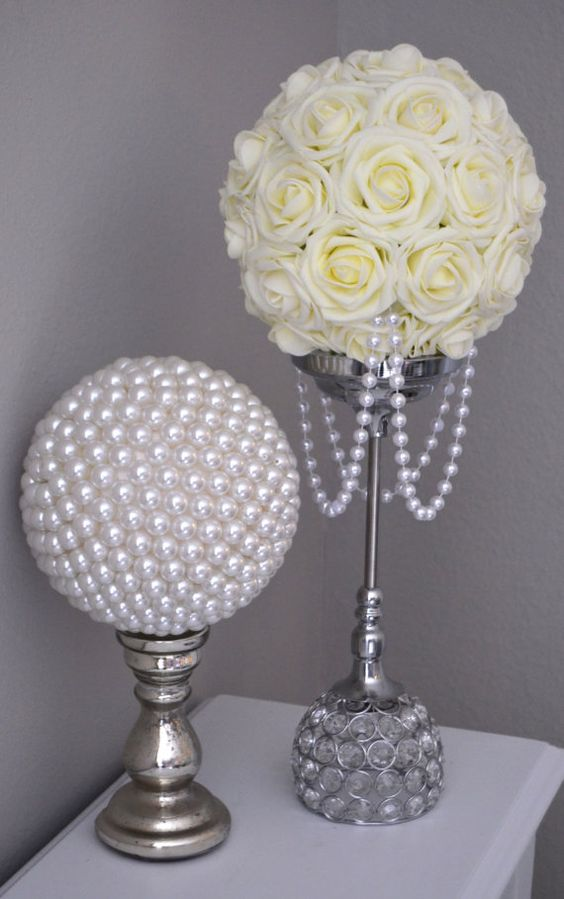 Ivory flower ball with draping pearls wedding decor