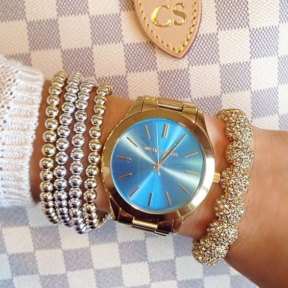 One of my favorite Michael Kors watches. I get compliments every time I wear it! And the photo doesn't do the blue any justice...