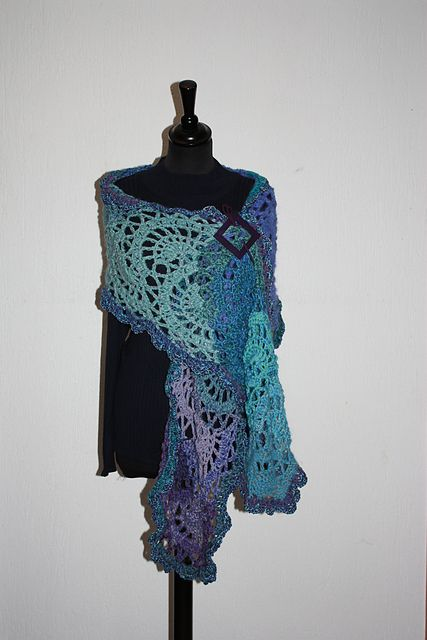 This looks a little like paisley to me.  Ravelry: Circular arcs pattern by Liane Staehler