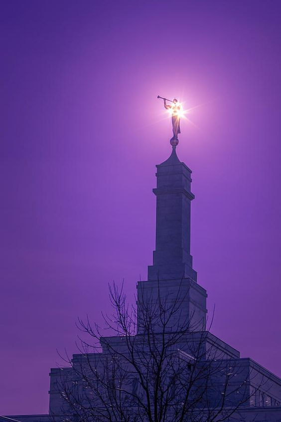 Angels Before Him by Greg Collins - Solar corona behind the statue of the angel Moroni atop the Columbus, Ohio temple of the Church of Jesus Christ of Latter-day Saints.