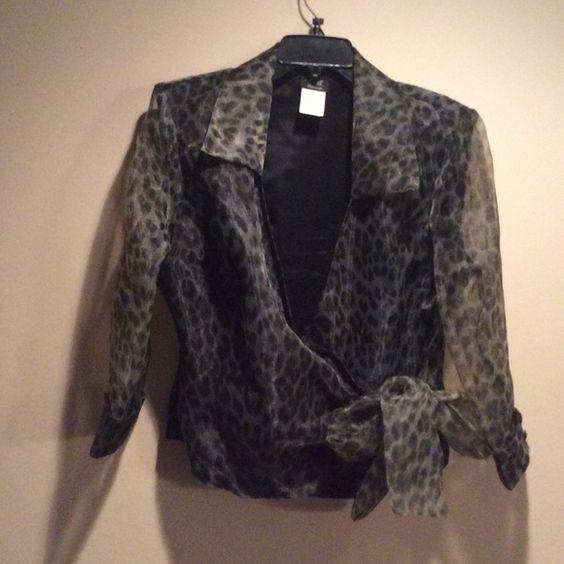 Leopard print wrap blouse Beautiful leopard print eveningwear. Great for wedding    Worn with black pants! Tops Blouses