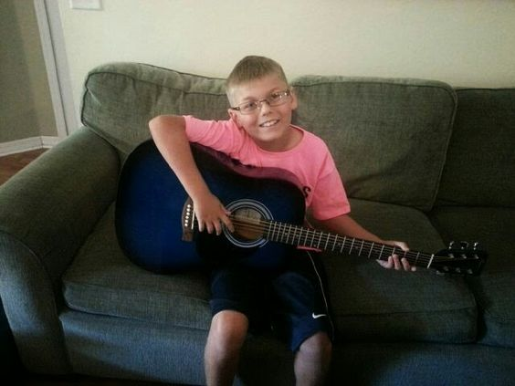 Elijah's 9 Granny Roxy got him his 1st guitar! 2014