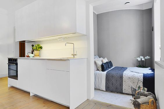 More of a nook than a room. Notice the carpet, great idea to divide the spaces! #compactliving