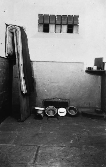Copy negative made from a conscientious objector postcard depicting the interior of a cell. Thought to be Wormwood Scrubs.
