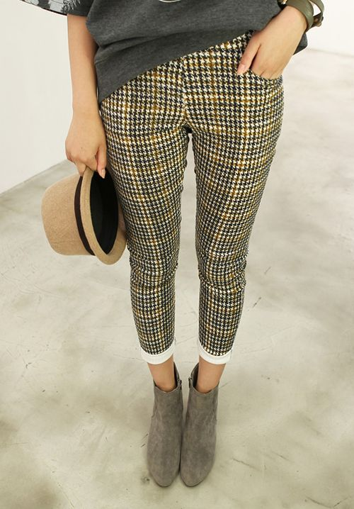 Love this look. The tweed looking trousers and the grey boots and tee make this outfit look really cool.