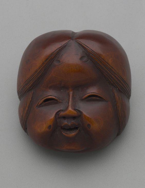 Wooden mask of Otafuku. Japan. Probably 19th century Netsuke, wood