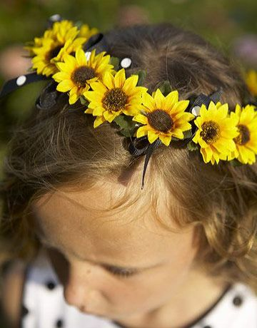 ...if you wanna go all out sunflowers... you could use them here and there for decor on your flower girl/ring bearer, if you have them.