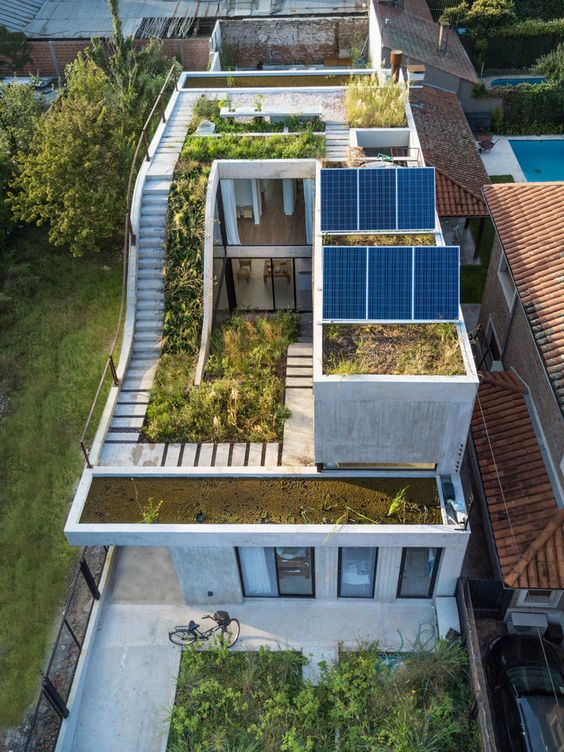 a rooftop garden and solar panel on a home's rooftop #garden #rooftopGarden #roof #homeImprovements #containers #outdoorSpace