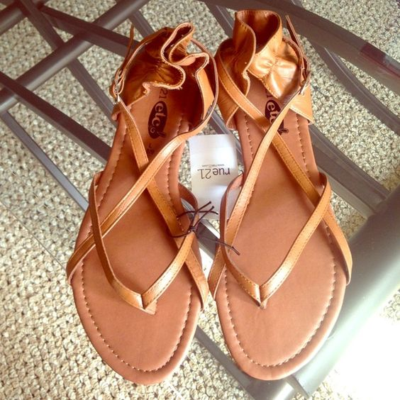 Brown Sandals These are cute rue 21 NWT brown sandals. Great for any occasion. Has a adjustable buckle on the side to get them on easily! Rue 21 Shoes Sandals