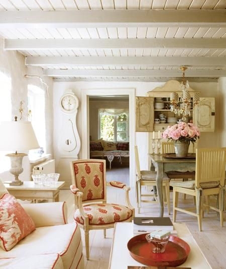 Swedish antique dining area, Mora clock, and living room in a farmhouse. Beautiful Classically Refined Rooms on Hello Lovely Studio.