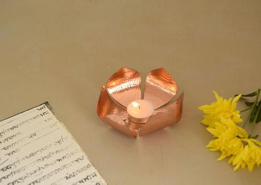 A copper votive