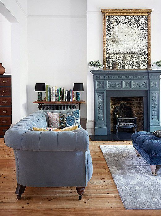 Glamorous Traditional Styled Living Room With Slate Gray Painted Fireplace With Antiq Victorian Living Room Chesterfield Sofa Living Room Blue Rugs Living Room