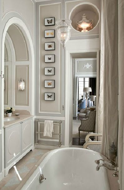 Impeccable moldings and art in a lofty beautiful luxurious sophisticated bathroom in a Paris apartment by Jean Louis Deniot Interior Design, Paris.