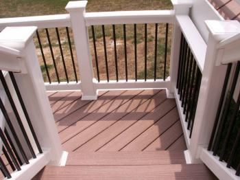 deck railings - cedar floor, white railings and posts with black balusters