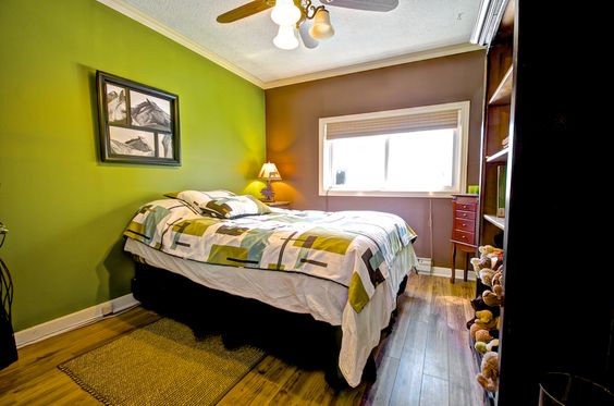 This green accent wall in the second bedroom is a bold punch of colour against the brown floor and walls!  #Orangeville #OrangevilleOntario #OrangevilleRealEstate