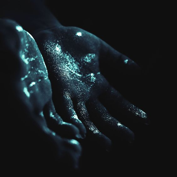 I wiped at my face, and when I pulled my hands down, I gaped. Pale green light - like drops of paint - glowed in flecks on my hand.