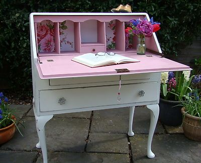 writing bureau painted neutral on the outside with a splash of colour on the inside
