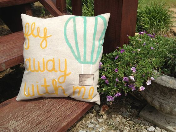 fly away with me hot air balloon pillow- fiber filled. so cute. $18.00, via Etsy.