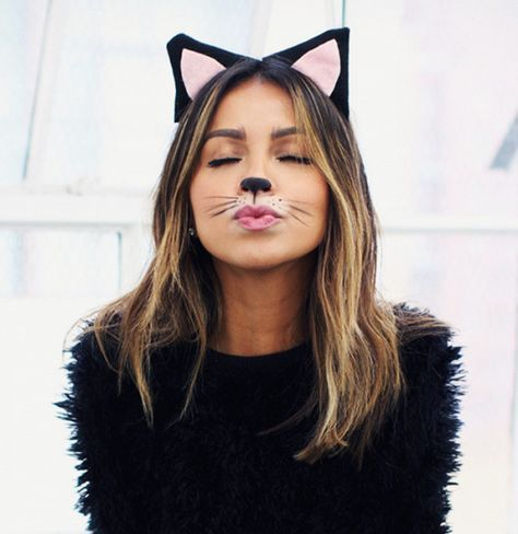 To be a house cat for Halloween all you need is black and white eyeliner and a pair of ears.