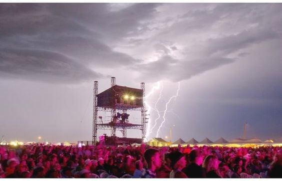 Lighting strikes in the distance as Toby Keith performs on the main stage at the Big Valley Jamboree in Camrose, Alta. on August 4, 2012. #bvj #bvj2012