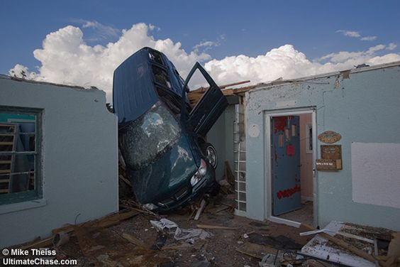 Greensburg Kansas EF 5 - An SUV, over 2000 lbs of vehicle, lobbed into a kids school hallway.I do hope the open driver's door doesn't mean someone was in it for that ride!