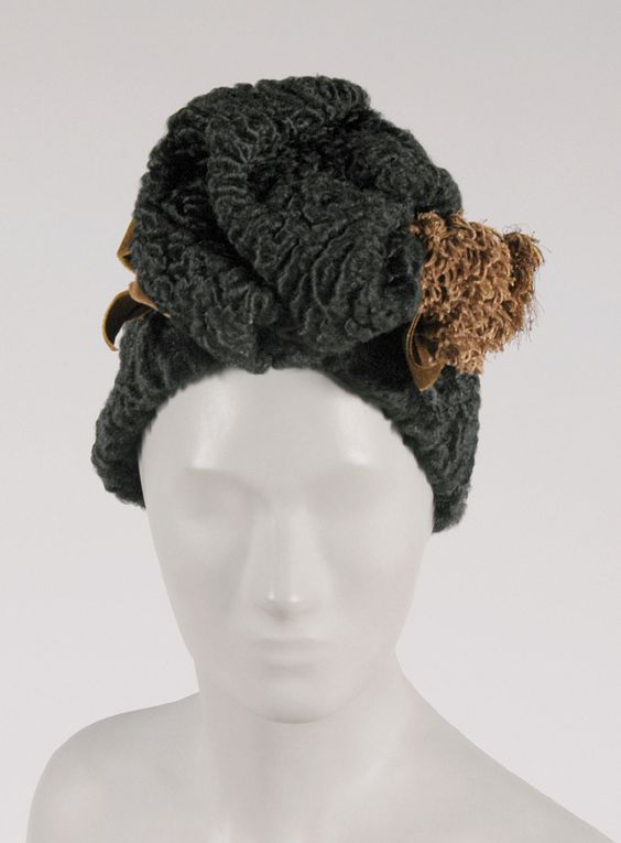 Woman's Fur Hat with Two Hat Pins  Braagaard Inc., New York  Date: 1940s Medium: Black Persian lamb fur, brown velvet ribbon  Accession Number: 2001-122-7a--c