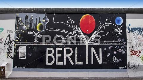 Graffiti On Berlin Wall At East Side Gallery Stock Photo 40729630