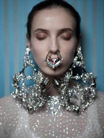 Nose piercings at Givenchy Couture...  I really don't know what to say...