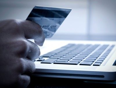 Laptop shopper with credit card PPT Backgrounds