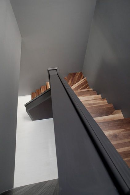 Encouraging movement or accentuating a transition, walls have the potential to give stairs the character of rooms