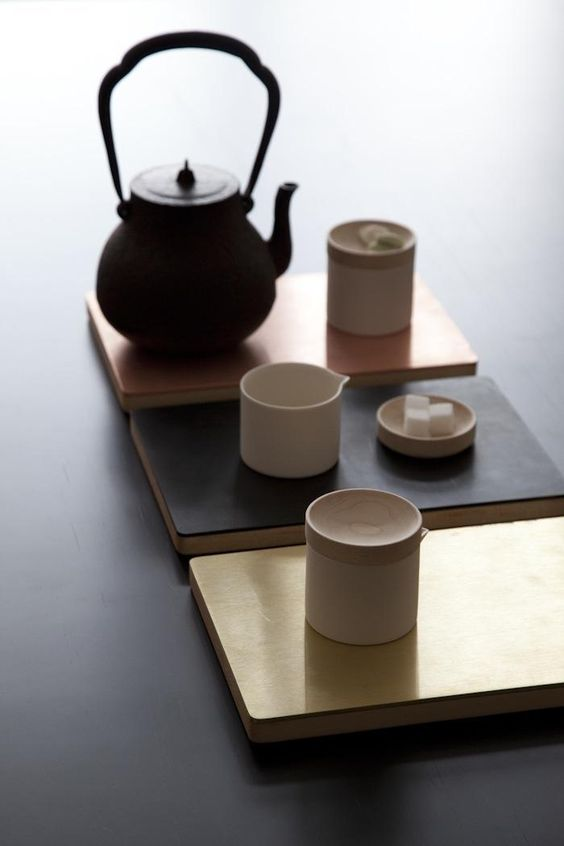 Reversible hard maple trays in pure brass, blackened steel and copper by Mjolk: Remodelista