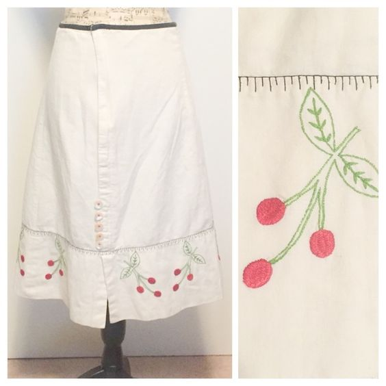 """Anthropologie Ivory Cream Retro Cherry Skirt Charming skirt by Snak from Anthropologie. This skirt is made from an off-white cotton/flax blend. Decorative buttons adorn the split on the hem above the right knee. The hem is embroidered with a rustic cherry motif. Fully lined and zipper closure.  Size 4 Length 24.4"""" Waist 28.5"""" 85% Cotton 15% Flax Hand Wash Cold Anthropologie Skirts"""