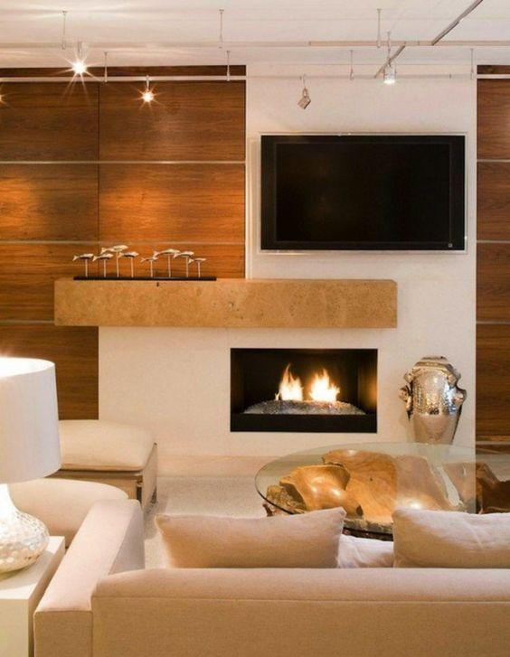 salon de luxe en tons chaleureux: fixation murale tv et cheminée