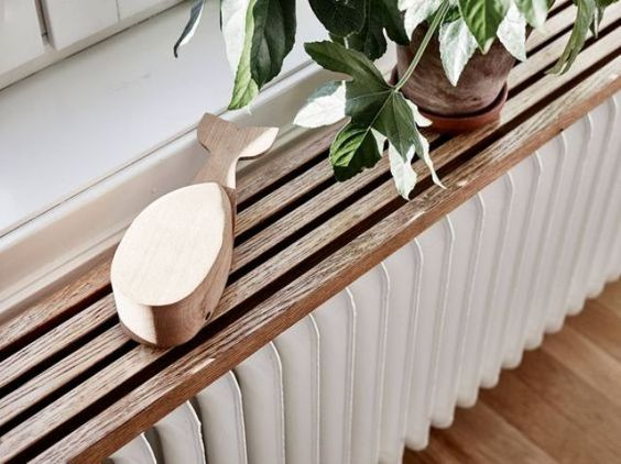 plywood plank shelf over a radiator:
