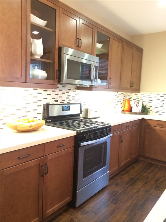 Medium Brown Kitchen Cabinets W Light Quartz Countertop And