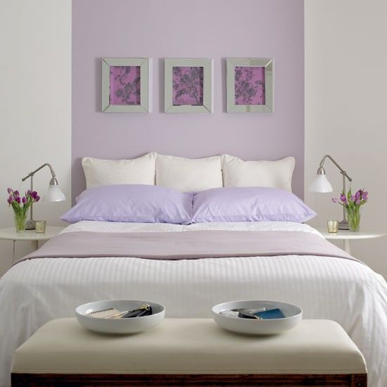 Fresh lilac bedroom  The panel behind the bed has been painted in warm lilac to match the brightly coloured bed linen, giving the bedroom a fresh look. The wall art in a deeper colour contrasts with the panel to create a focal point to the room. The scheme is finished off with simple accessories placed symmetrically on tables next to the bed.