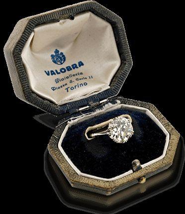 Estate Diamond Ring in its original box featuring 5.06 carats old European cut diamond in a platinum crown setting. Circa 1920s.
