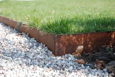 Stylish grass divider to keep gravel out of grass for Lawn divider