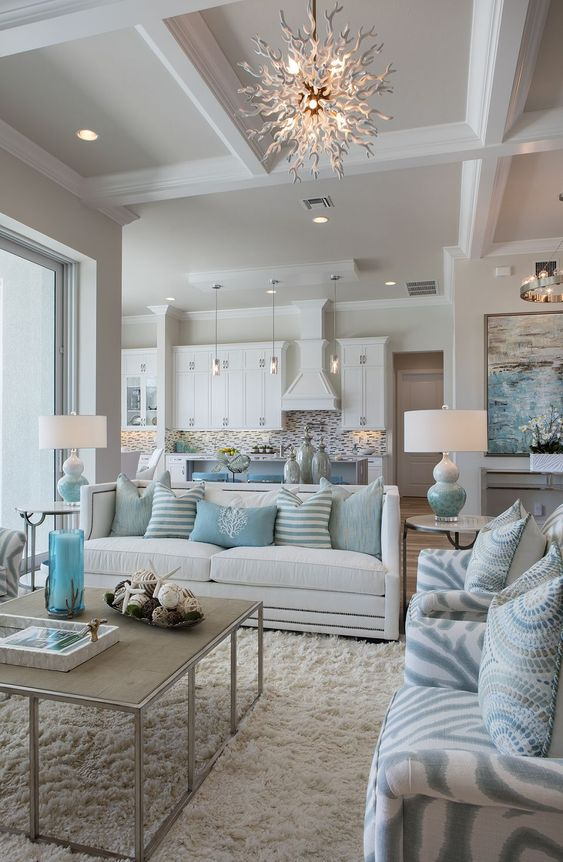 Light blue & white home decor with different patterns and textures create a calm and serene mood in this stunning living room.: