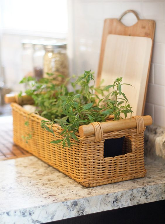 This Long Narrow Pole Handle Basket from www.basketlady.com is perfect for holding a kitchen herb garden. #wicker #gardenfresh