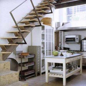 Salvage Chic Kitchen *   Recycled storage pieces, industrial stairs and an open island inject character.