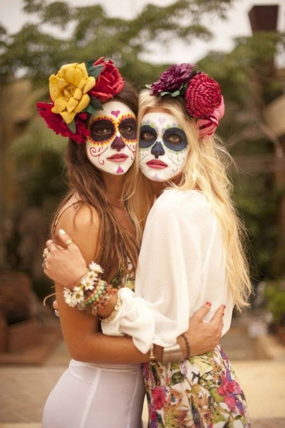 Grab some colorful face makeup and transform into Sugar Skulls for Halloween.: