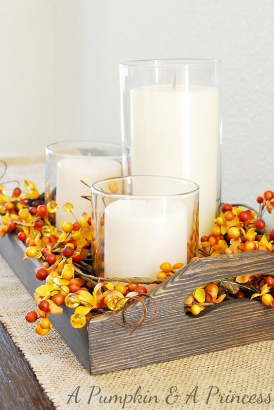 A simple berry pick fall centerpiece on stained serving