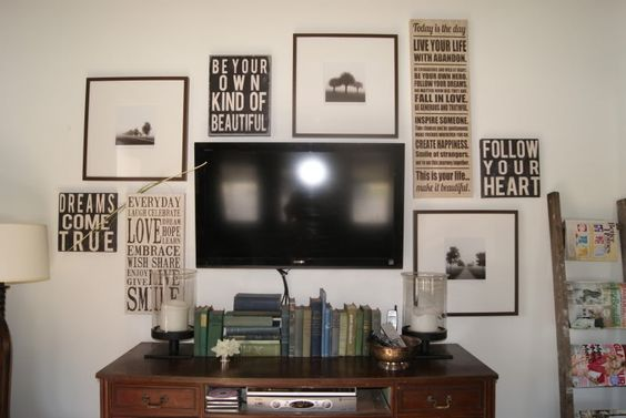 """I've been looking for a way to decorate our wall where the tv is...it's kinda difficult to decorate around 55"""" lol...I wonder wonder if something like this would look stupid...the whole wall is empty and it bugs me haha."""