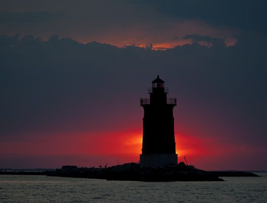 Happy National Lighthouse Day! Sunset at Delaware's Breakwater Lighthouse.