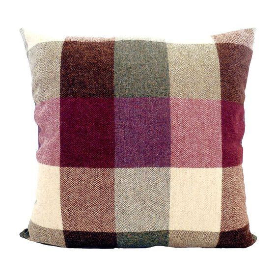 Create a traditional country home inspired look with this woollen cushion, featuring a large checked design in plum, green and cream for rustic style.