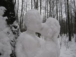 Instead of building a snowman someone built a couple kissing. Kind of warms your heart in the cold.